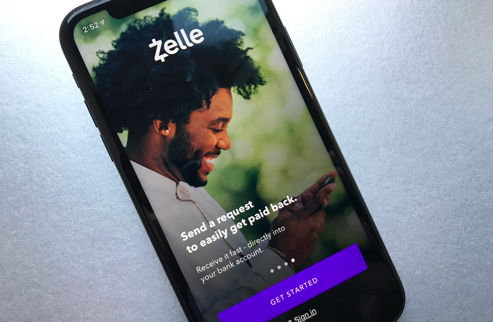 zelle, image of man, smiling looking down at his cellphone